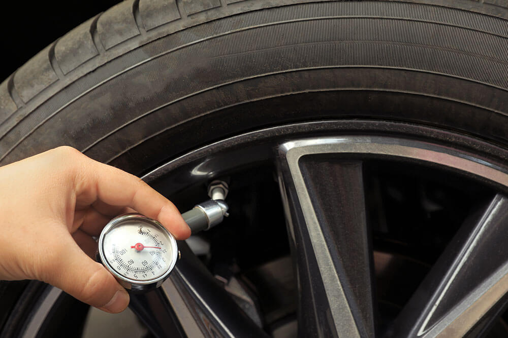 Does Putting Extra Air in the Tires Help a Car Cope with Carrying Extra Weight